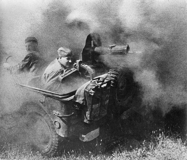 The Enemy, 1944. With the outbreak of world war two, photojournalism was enlisted in defence of Mother Russia. In this photo by Anatoli Egorov, who was wounded in action, corporal Stepan Vasiljevich Ovcharenko shoots at enemy troops with a machine gun. (Photo by Anatoli Egorov/Lumiere Brothers Center for Photography)