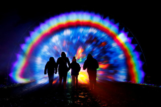 """Members of the public interact with Artist Benjamin Clegg's """"Rainbow in the Dark"""" at Light Up Trails at The Wiston Estate, amid the spread of the coronavirus disease (COVID-19), in Steyning, West Sussex, Britain, December 9, 2020. (Photo by Paul Childs/Reuters)"""