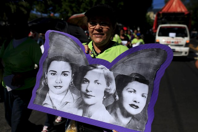 A woman holds a portrait of the Mirabal sisters as she participate in a commemoration event for the International Day for the Elimination of Violence against Women, in San Salvador, El Salvador, November 25, 2015. (Photo by Jose Cabezas/Reuters)
