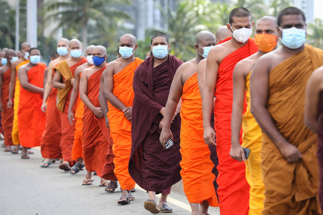 Sri Lankan Buddhist monks march to Presidential Secretariat during a protest against burial of Covid-19 victims in Colombo, Sri Lanka, 28 December 2020. A group of Buddhist monks staged a protest in front of the Presidential Secretariat on 28 December against the burial of the Covid-19 victims. They say the cremation of Covid-19 should be made mandatory. Sri Lankan Muslims continue to protest against the cremation of Covid-19 victims. (Photo by Chamila Karunarathne/EPA/EFE)