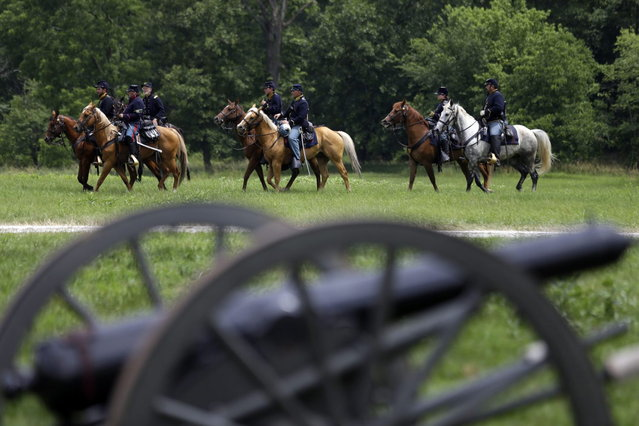Mounted Union reenactors drill during ongoing activities commemorating the 150th anniversary of the Battle of Gettysburg, Thursday, June 27, 2013, in Gettysburg, Pa.  Union forces turned away a Confederate advance in the pivotal battle of the Civil War fought July 1-3, 1863, which was also the war's bloodiest conflict with more than 51,000 casualties. (Photo by Matt Rourke/AP Photo)