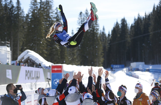 First place, Czech Republic's Marketa Davidova is tossed in the air by her team during celebration after the women's 15 km individual competition at the World Championships Biathlon event in Pokljuka, Slovenia, Tuesday, February 16, 2021. (Photo by Darko Bandic/AP Photo)
