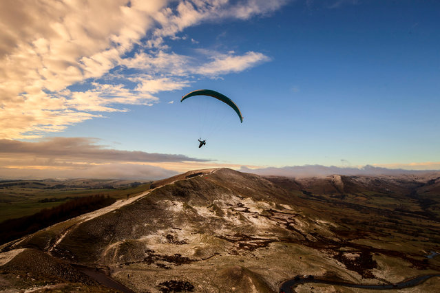 Paragliders fly over Mam Tor, a 517m hill near Castleton in Derbyshire, United Kingdom on January 2, 2021. (Photo by Danny Lawson/PA Images via Getty Images)