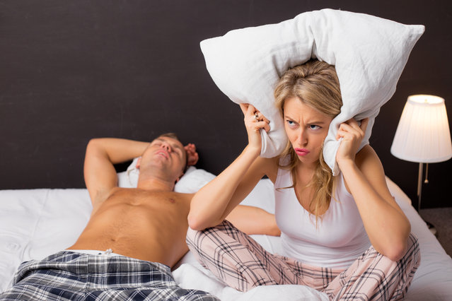 Woman is annoyed because of the man who snores. (Photo by Grinvalds/Getty Images)