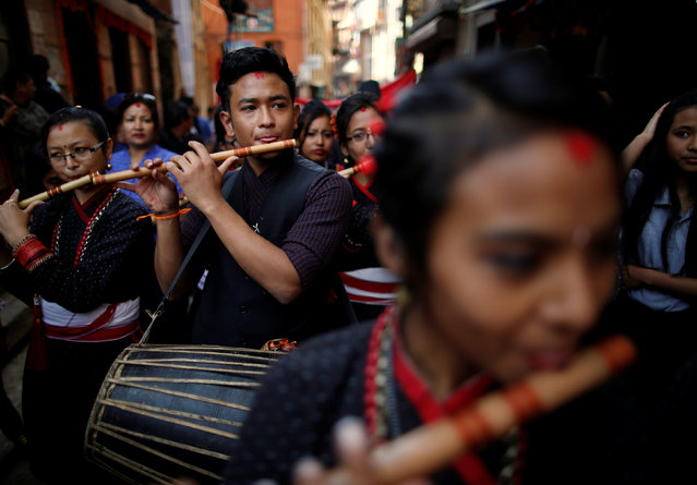 Participants from Newar community in traditional attire, play musical instruments during the Newari New Year parade that falls during the Tihar festival, also called Diwali, in Kathmandu, Nepal October 31, 2016. (Photo by Navesh Chitrakar/Reuters)