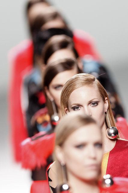 Models display Autumn/Winter designs by Maria Escote at Madrid's Fashion Week in Madrid, Spain, Tuesday, Feb. 10, 2015. (AP Photo/Daniel Ochoa de Olza)