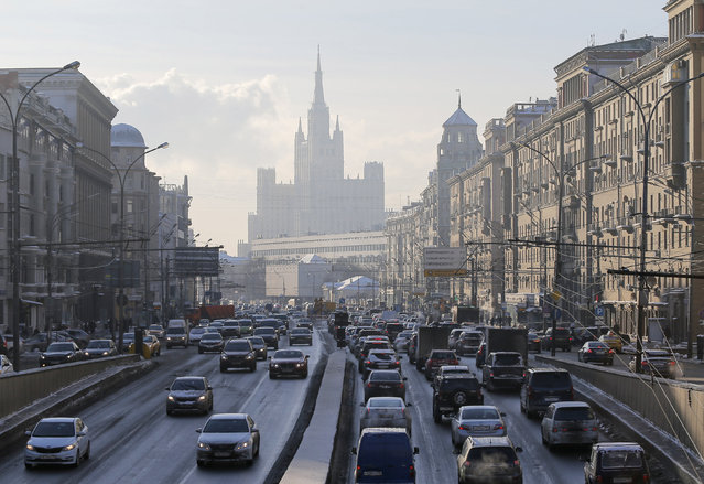 Cars drive along the Garden Ring road, with a residential building at Kudrinskaya Square seen on the background, in Moscow, Russia, January 11, 2016. (Photo by Maxim Shemetov/Reuters)