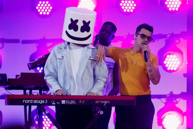 Joe Jonas of Jonas Brothers and Marshmello perform at the 2021 Billboard Music Awards outside the Microsoft Theater in Los Angeles, California, U.S. May 23, 2021. (Photo by Mario Anzuoni/Reuters)