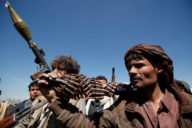 Pro-Houthi tribesmen carry their weapons during a gathering held to mobilize fighters for battles against government forces, in Sanaa, Yemen November 24, 2016. (Photo by Khaled Abdullah/Reuters)