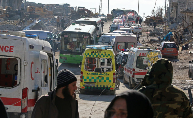 Ambulances and buses wait as they evacuate people from a rebel-held sector of eastern Aleppo, Syria December 15, 2016. (Photo by Abdalrhman Ismail/Reuters)