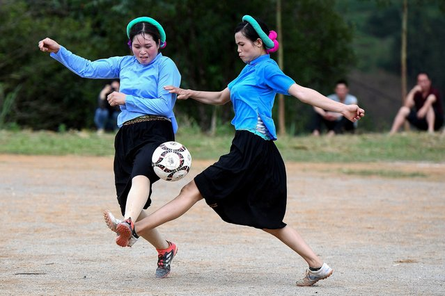 Ethnic San Chi women dressed in traditional costumes play a friendly football match as part of the Soong Co festival celebrations in northern Vietnam's Quang Ninh province on April 24, 2021. (Photo by Nhac Nguyen/AFP Photo)
