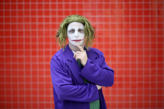 Adam Richards dressed as The Joker from the Batman comic book poses for a photograph at the London supercomic convention at the Excel centre, east London, March 14, 2015. (Photo by Paul Hackett/Reuters)