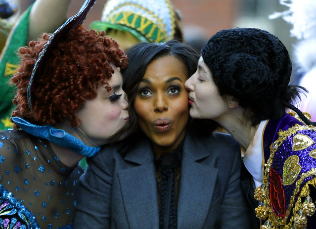 Actress Kerry Washington, Harvard University's Hasty Pudding Theatricals' Woman of the Year, is kissed by actors in drag, Robert Fitzpatrick, left, and David Sheynberg, right, as she is paraded through the streets of Harvard Square, Thursday, January 28, 2016, in Cambridge, Mass. (Photo by Elise Amendola/AP Photo)