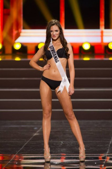 This photo provided by the Miss Universe Organization showsSimona Burbaite, Miss Lithuania 2013, competes in the swimsuit competition during the Preliminary Competition at Crocus City Hall, Moscow, on November 5, 2013. (Photo by Darren Decker/AFP Photo)