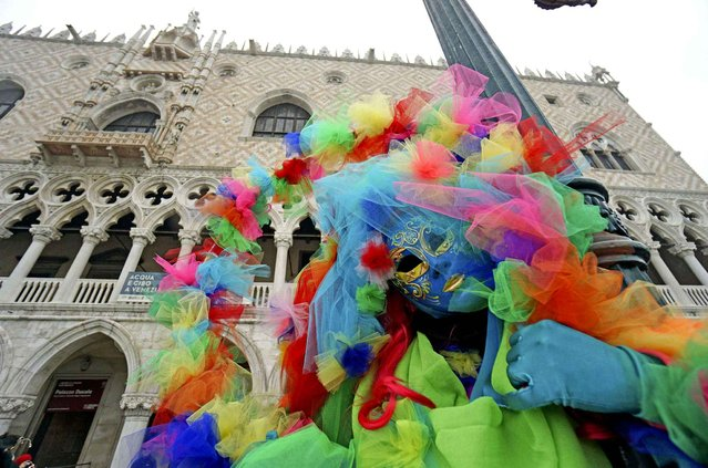 Masked people pose in St. Mark's Square on the occasion of the Venice Carnival, in Venice, Italy, Saturday, January 30, 2016. People attended the Venice Carnival, celebrated Saturday under heightened security following the sexual assaults on New Year's Eve in Cologne and the ongoing terror threat in Europe. Authorities have increased surveillance throughout the city, including the number of officers on patrol, both under-cover and in uniform. (Photo by Andrea Merola/ANSA via AP Photo)