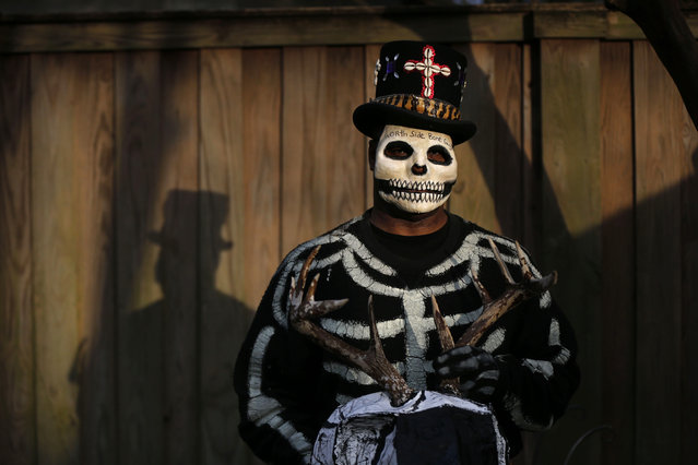 """Bruce """"Sunpie"""" Barnes, head of the Mardi Gras North Side Skull & Bone Gang, poses with his accoutrements for upcoming Mardi Gras day, in New Orleans, Tuesday, February 2, 2016. Their costumes are intended to represent the dead, and Barnes said they bring a serious message, reminding people of their mortality and the need to live a productive and good life. (Photo by Gerald Herbert/AP Photo)"""