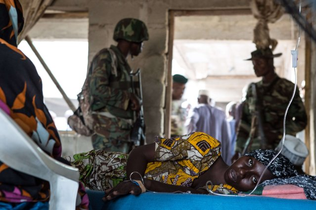 A young woman lies ill in a makeshift hospital room in Maiduguri on March 25, 2015. Nigeria's military has retaken the northeastern town of Bama from Boko Haram, but signs of mass killings carried out by Boko Haram earlier this year remain. Approximately 7,500 people have been displaced by the fighting in Bama and surrounding areas. (Photo by Nichole Sobecki/AFP Photo)