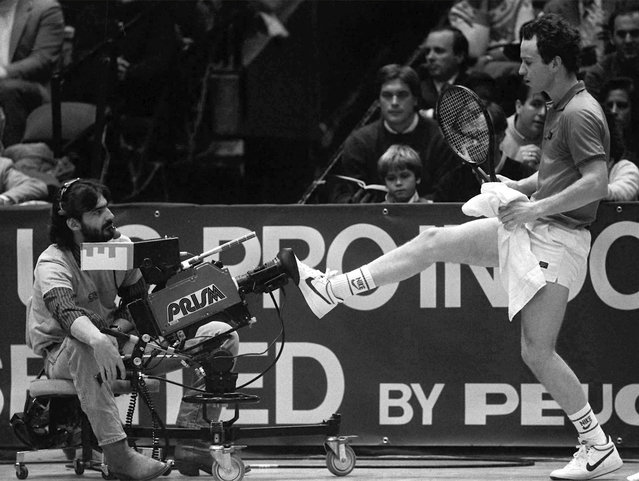 John McEnroe kicks back a television camera that he felt was crowding him on the court during the finals of the U.S. Pro Indoor Tennis Championships in Philadelphia January 27, 1985. McEnroe defeated Czech Miroslav Mecir to win the tournament. (Photo by Amy Sancetta/AP Photo)