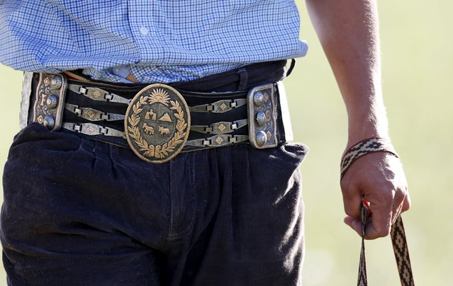 A gaucho wears a belt with a buckle with the Uruguayan shield during the annual celebration of Criolla Week in Montevideo, March 30, 2015. (Photo by Andres Stapff/Reuters)