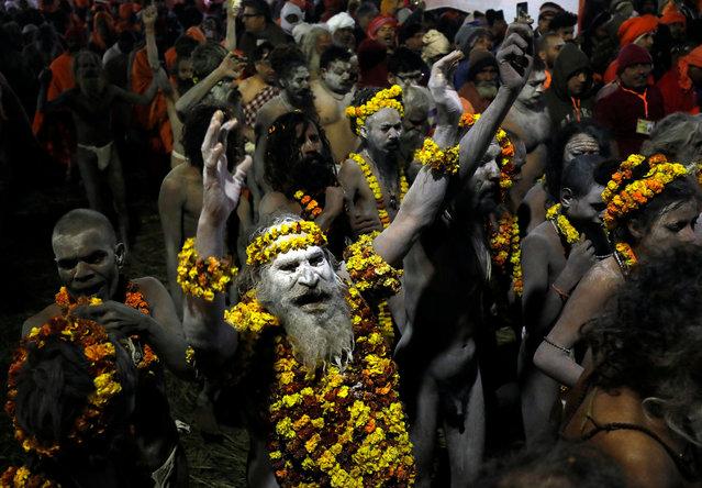 "Naga Sadhus or Hindu holy men arrive to take a dip during the first ""Shahi Snan"" (grand bath) at ""Kumbh Mela"" or the Pitcher Festival, in Prayagraj, previously known as Allahabad, India, January 15, 2019. (Photo by Anushree Fadnavis/Reuters)"