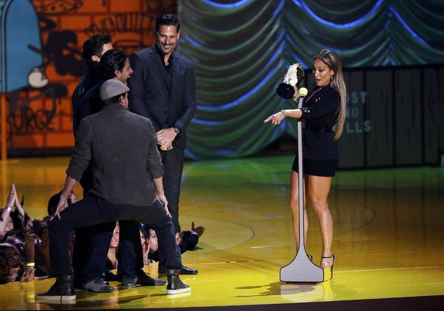 Actress Jennifer Lopez reacts to actor Channing Tatum (L) dancing on stage with actors Adam Rodriguez (C), Matt Bomer and Joe Manganiello (R) looking on during the 2015 MTV Movie Awards in Los Angeles, California April 12, 2015. (Photo by Mario Anzuoni/Reuters)