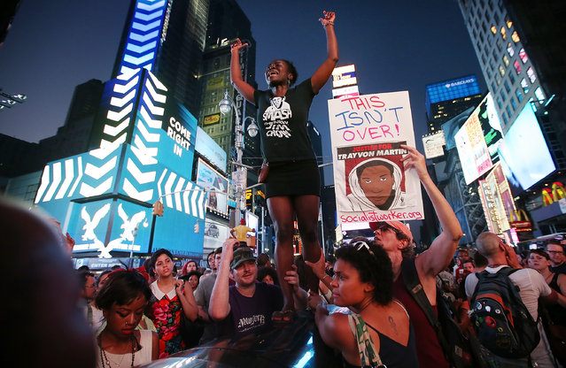 Trayvon Martin supporters rally in Times Square while blocking traffic after marching from a rally for Martin in Union Square in Manhattan on July 14, 2013 in New York City. George Zimmerman was acquitted of all charges in the shooting death of Martin July 13 and many protesters questioned the verdict. (Photo by Mario Tama/Getty Images)