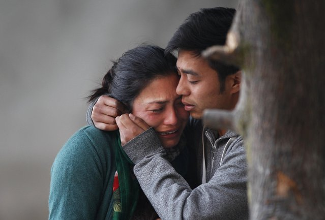 Family members of plane crash victims cry as they wait to receive their bodies in Kathmandu, Nepal, Thursday, February 25, 2016. Authorities reportedly recovered all 23 bodies of people, including two foreigners, killed in an air crash after their small plane crashed into a mountain in a remote Himalayan region amid bad weather on Wednesday. (Photo by Niranjan Shrestha/AP Photo)