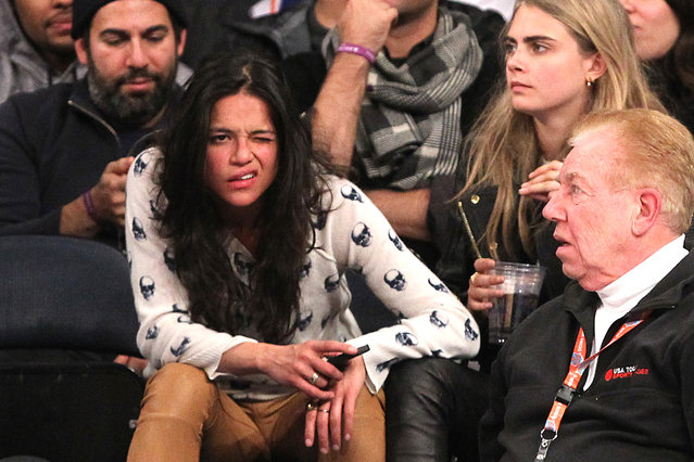 1/7/2014 - Detroit Pistons vs. New York Knicks at Madison Square Garden - Actress Michelle Rodriguez and model Cara Delevingne sitting in the front row during the 4th quarter. The two were hugging and touching each other and Rodriguez appeared to be very intoxicated.