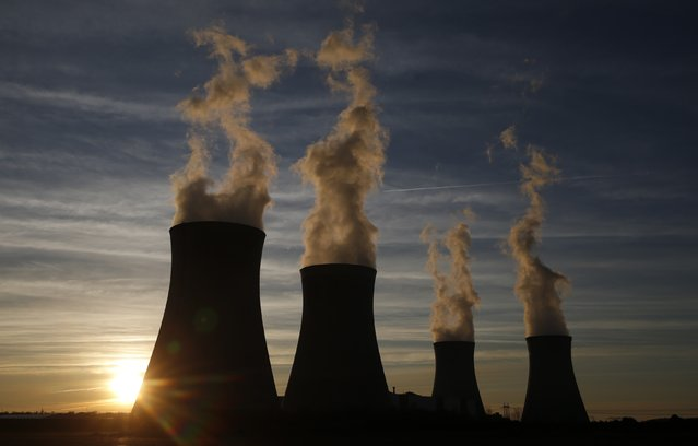Steam rises at sunset from the cooling towers of the Electricite de France (EDF) nuclear power station in Dampierre-en-Burly, March 8, 2015. (Photo by Christian Hartmann/Reuters)