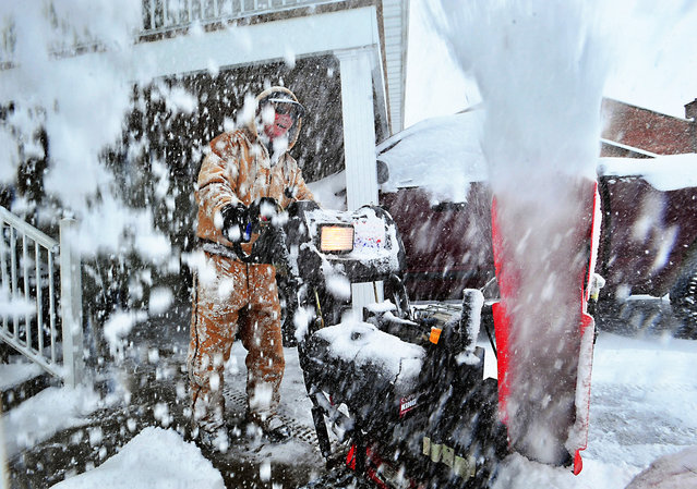 Terry Jones runs a snowblower at the Chambersburg Club during the biggest winter storm of the season in Chambersburg, Pennsylvania. (Photo by Markell DeLoatch/Public Opinion)