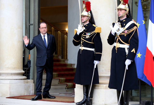 French President Francois Hollande waves outside the Elysee Palace in Paris, France, February 7, 2017. (Photo by Jacky Naegelen/Reuters)