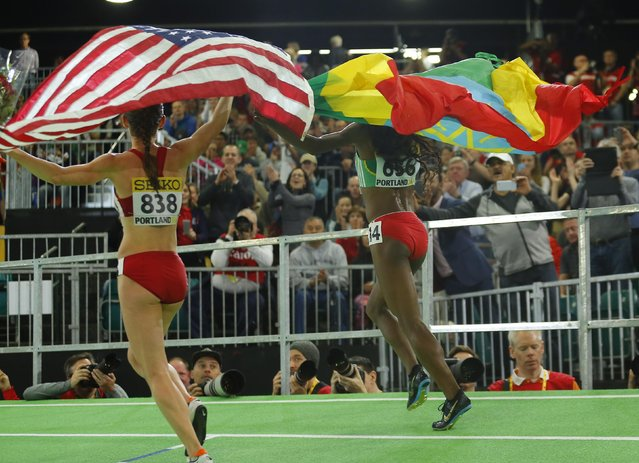Gold medalist Genzebe Dibaba of Ethiopia (R) and Bronze medalist Shannon Rowbury of the U.S. run with their country's flags after the women's 3000 meters during the IAAF World Indoor Athletics Championships in Portland, Oregon March 20, 2016. (Photo by Mike Blake/Reuters)