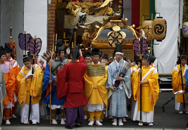 Shinto priests and Shinto studies specialty students attend a ritual for the Kanda festival at the Kanda-Myojin shrine in Tokyo May 9, 2015. (Photo by Toru Hanai/Reuters)
