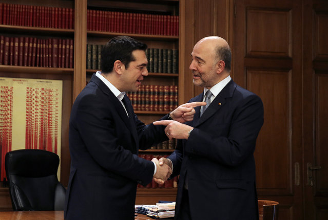 Greek Prime Minister Alexis Tsipras (L) welcomes European Economic and Financial Affairs Commissioner Pierre Moscovici at the Maximos Mansion in Athens, Greece February 15, 2017. (Photo by Alkis Konstantinidis/Reuters)