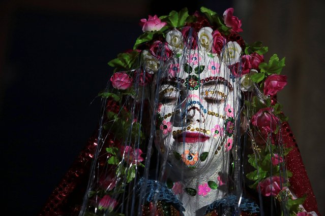 A Bulgarian Muslim bride Kadrie Avdikova has her face decorated with a special wedding makeup at the end of a two-day wedding ceremony in the Rhodope Mountains village of Ribnovo, 200 kilometers (124 miles) south of capital Sofia, Sunday, February 23, 2014. (Photo by Valentina Petrova/AP Photo)