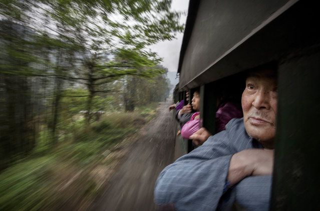 Local villagers ride a local coal powered steam train on March 27, 2015 at a station in the town of Shixi , Sichuan Province, in Southern China. While China boasts the world's most extensive high-speed rail infrastructure. (Photo by Kevin Frayer/Getty Images)