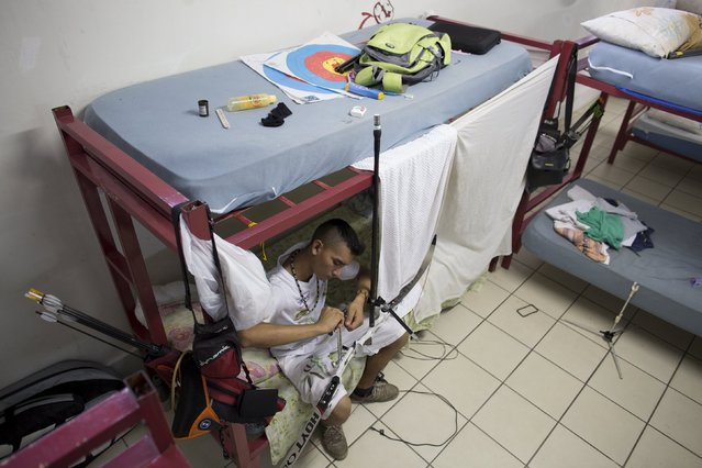 Kambeba Indian, Dream Braga, 18, is seen at the dormitory of a training centre in Manaus, Amazon state May 7, 2015. (Photo by Bruno Kelly/Reuters)