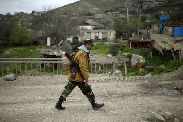 A volunteer walks on a road in the Nagorno-Karabakh's village of Talish April 6, 2016. (Photo by Reuters/Staff)