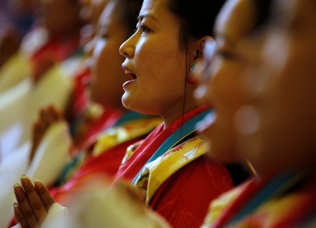 """Tibetan girls in traditional attire perform during a function organised to mark """"Losar"""", or the Tibetan New Year, in Kathmandu, Nepal March 1, 2017. (Photo by Navesh Chitrakar/Reuters)"""