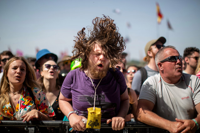 A festival-goer headbangs to the music of The Vaccines on the Other Stage on the third day of the Glastonbury Festival of Music and Performing Arts on Worthy Farm near the village of Pilton in Somerset, South West England, on June 28, 2019. (Photo by South West News Service)