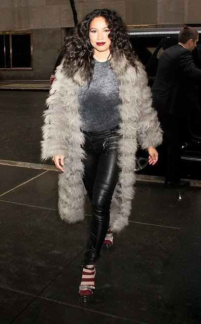 "New mom actress Jurnee Smollett-Bell spotted visits NBC Studios in NYC's Rockefeller Center on March 7, 2017 wearing a gray full-length fur, silver metallic sweater, black skinny leather pants, high heeled sandals with beige and wine striped socks. Smolett-Bell is promoting the WGN series ""Underground"". (Photo by Fortunata/Splash News)"