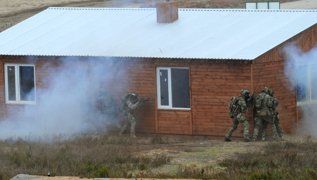 Soldiers attack a building during the NATO Noble Jump exercise on a training range near Swietoszow Zagan, Poland, Thursday, June 18, 2015. (AP Photo/Alik Keplicz)