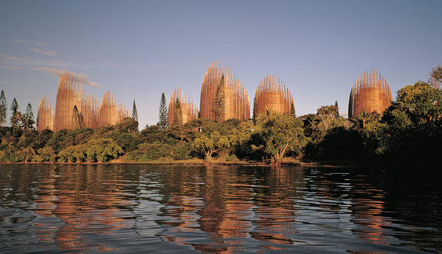 Jean-Marie Tjibaou cultural centre, Nouméa, New Caledonia, by Renzo Piano. The Pritzker-winning architect designed 10 interconnected turrets with a visual nod to the traditional huts of indigenous Kanak people. The iroko-wood slats are designed to protect those inside against sun and heat, while the structures are placed to help shield occupants against the Pacific wind. (Photo by John Gollings/Courtesy Renzo Piano and the Jean-Marie Tjibaou cultural centre/The Guardian)