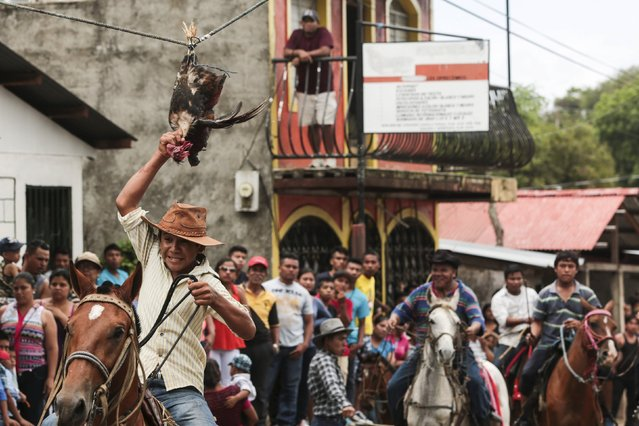 A youth riding a horse attempts to pull the head off a live rooster during celebrations in honour of San Juan Bautista in San Juan de Oriente town, Nicaragua, June 26, 2015. (Photo by Oswaldo Rivas/Reuters)