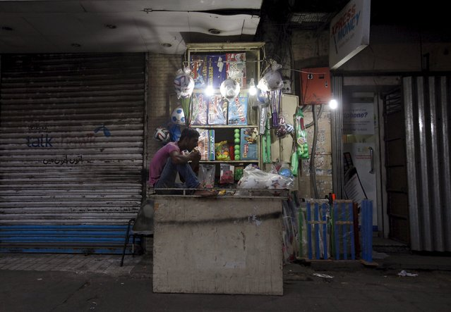 A youth breaks his fast during the month of Ramadan, at a sports item shop in Karachi, Pakistan, June 28, 2015. (Photo by Akhtar Soomro/Reuters)