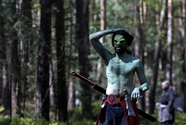 """A man dressed as a character from the computer game """"World of Warcraft"""" walks through a forest near the village of Sosnova, Czech Republic, April 30, 2016. (Photo by David W. Cerny/Reuters)"""