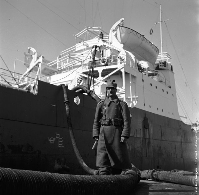 1955:  A Persian soldier guarding an oil production site belonging to the Iranian oil company at Abadan on the northern tip of the Persian Gulf