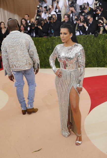 """Musician Kanye West and Kim Kardashian (R) arrive at the Metropolitan Museum of Art Costume Institute Gala (Met Gala) to celebrate the opening of """"Manus x Machina: Fashion in an Age of Technology"""" in the Manhattan borough of New York, May 2, 2016. (Photo by Eduardo Munoz/Reuters)"""