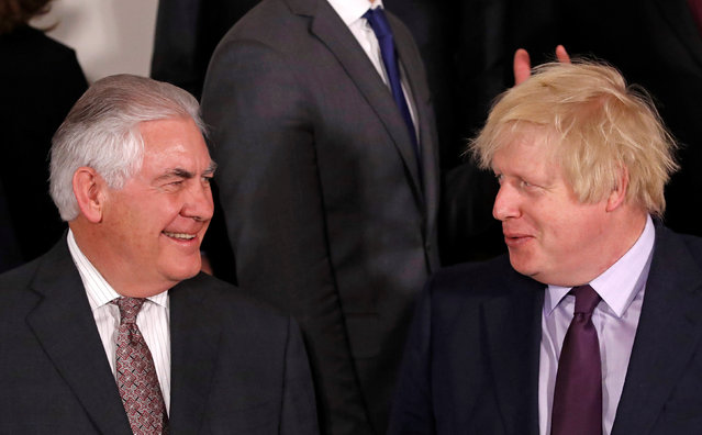 U.S. Secretary of State Rex Tillerson (L) and British Foreign Secretary Boris Johnson take part in a meeting of NATO foreign ministers at the Alliance's headquarters in Brussels, Belgium March 31, 2017. (Photo by Yves Herman/Reuters)