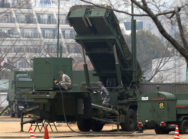 Japan Self-Defense Forces soldiers inject fuels into a unit of Patriot Advanced Capability-3 (PAC-3) missiles at the Defense Ministry in Tokyo, Japan, March 6, 2017. (Photo by Kim Kyung-Hoon/Reuters)